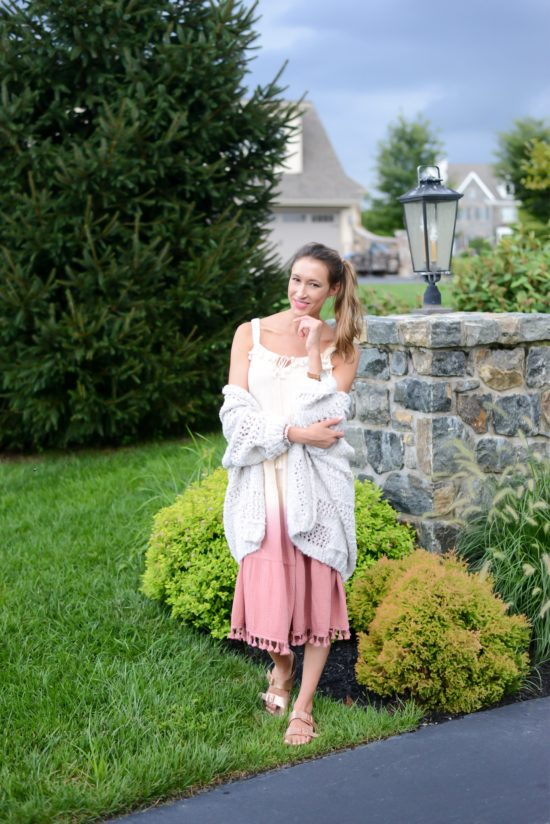 3 Ways to Wear Summer Maxi Dresses in the Fall- ombre tassel maxi dress, chunky cozy cardigan, and sandals, side ponytail