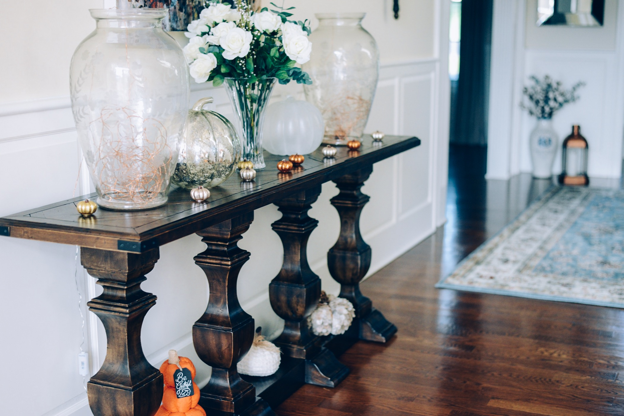 How I Decorated My Home Interior for Fall- Terrain lanterns with copper wire lights on console table