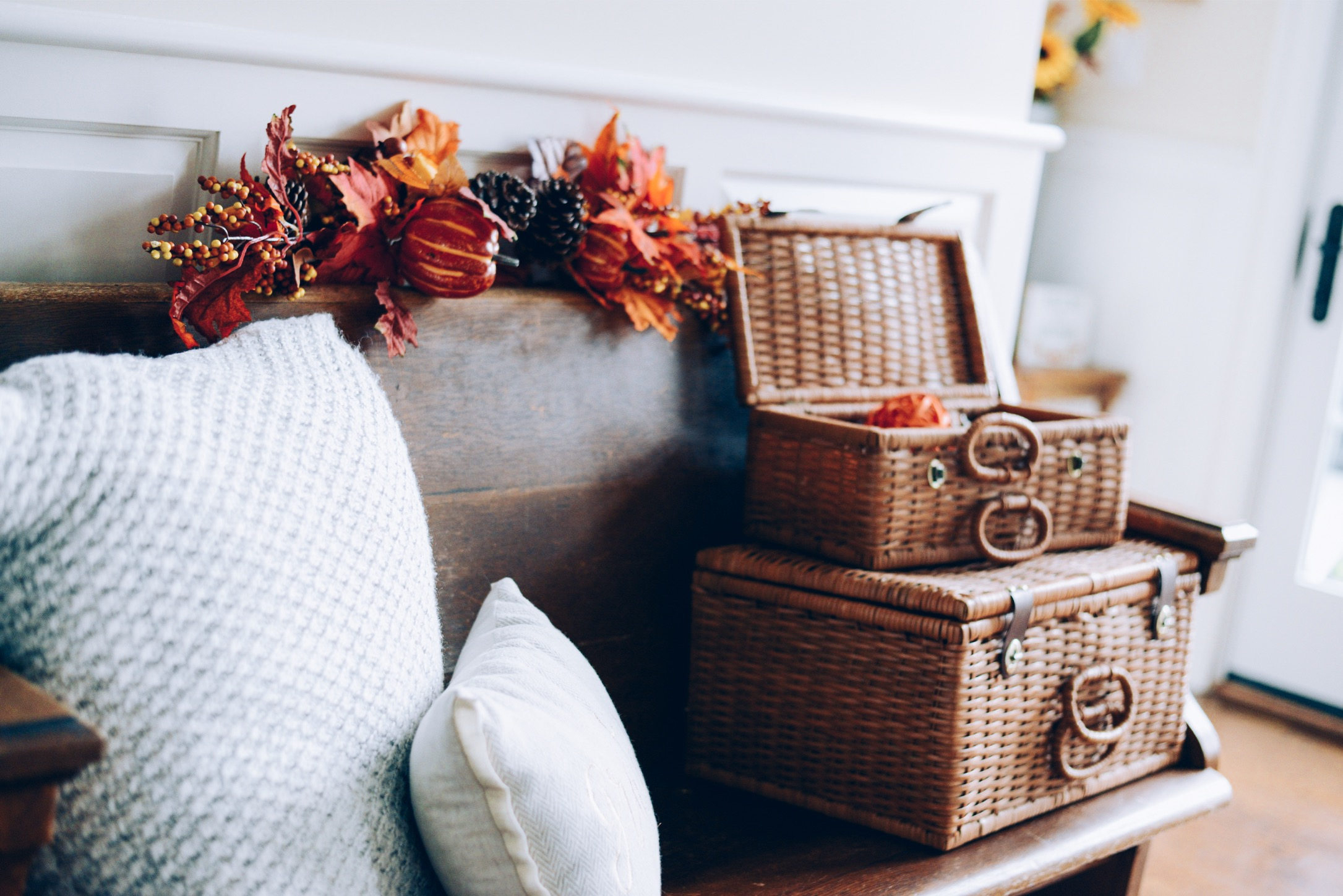 How I Decorated My Home Interior for Fall- antique church pew and vintage basket trunks