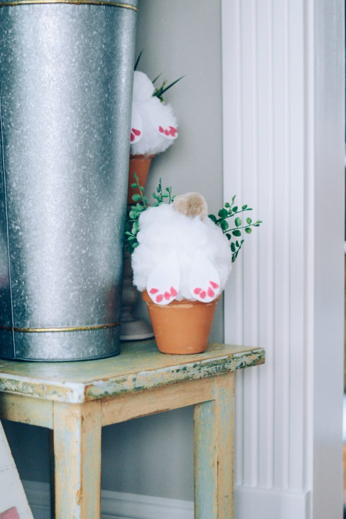 The Cutest DIY Spring/Easter Home Decor Idea- bunnies digging in a pot craft with pom poms