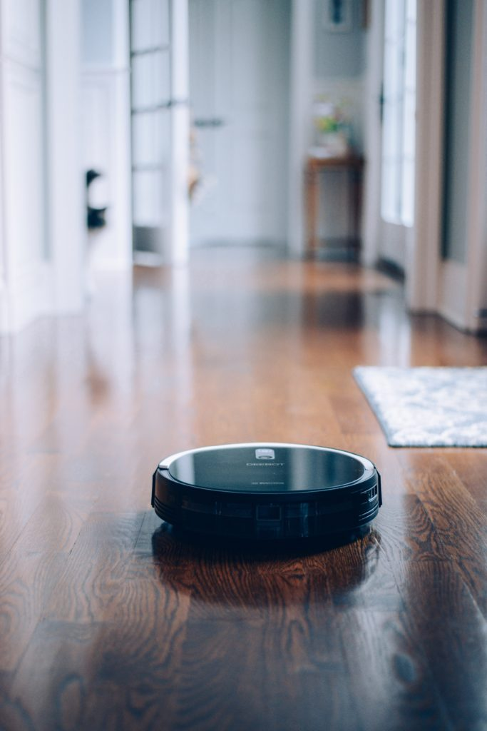 Deebot robotic vacuum on hardwood floor